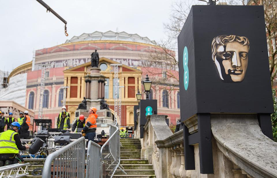 Setup of the red carpet for the BAFTA Film Awards begins at the Royal Albert Hall in London, where they will be held on Sunday. (Photo by Matt Crossick/PA Images via Getty Images)