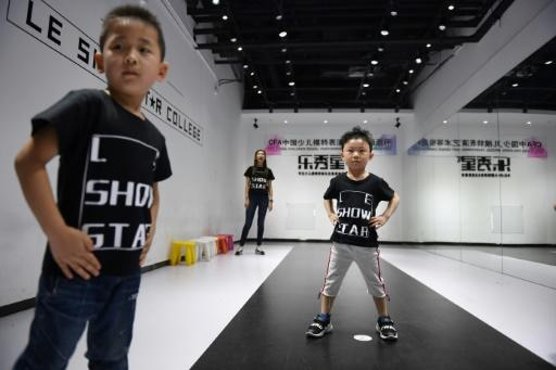 """China is seeing the rise of """"kidfluencers"""" sponsored by brands to promote products on social media is spurring greater demand for young models -- but experts warn of the heavy cost of pursuing such deals"""