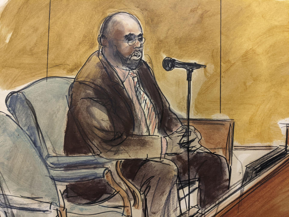 In this courtroom sketch, Larry Hood, former security and body guard for R. Kelly, testifies for the defense during the R. Kelly sex trafficking trial, Monday, Sept. 20, 2021, in New York. (AP Photo/Elizabeth Williams)