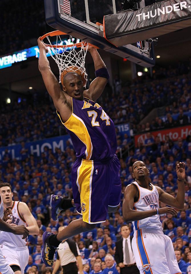 OKLAHOMA CITY, OK - MAY 21:  Kobe Bryant #24 of the Los Angeles Lakers gets a slam dunk against the Oklahoma City Thunder during Game Five of the Western Conference Semifinals of the 2012 NBA Playoffs at Chesapeake Energy Arena on May 21, 2012 in Oklahoma City, Oklahoma.  NOTE TO USER: User expressly acknowledges and agrees that, by downloading and or using this photograph, User is consenting to the terms and conditions of the Getty Images License Agreement.  (Photo by Ronald Martinez/Getty Images)