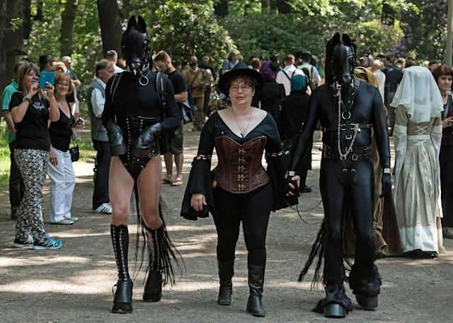 "<p>Participants of the so called ""Victorian Picnic"" walk in fancy costumes during the Wave Gothic Festival (WGT) in Leipzig, Germany, Friday, June 2, 2017. (AP Photo/Jens Meyer) </p>"