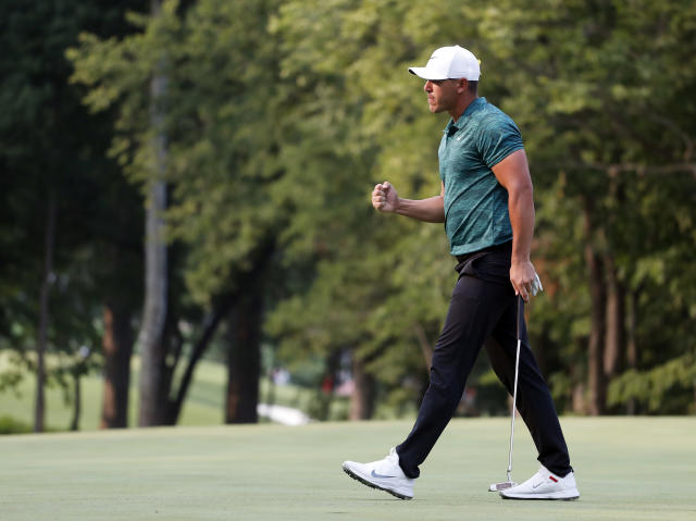 FILE- In this Aug. 12, 2018, file photo Brooks Koepka celebrates after making his birdie putt on the 16th green during the final round of the PGA Championship golf tournament at Bellerive Country Club in St. Louis. His 4-iron into this par 3 was among the best shots hit in the majors last year. (AP Photo/Jeff Roberson, File)