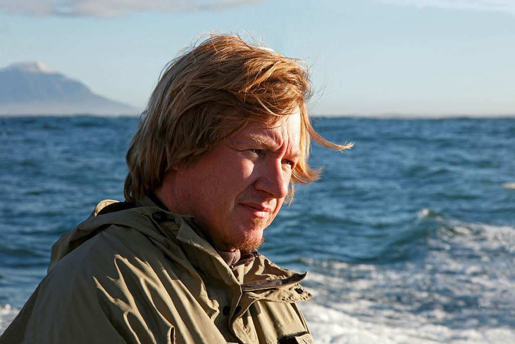 """Filmmaker Jeff Kurr in False Bay South Africa at the notorious Seal Island as seen on """"<a href=""""/ultimate-air-jaws/show/46651"""">Ultimate Air Jaws</a>."""""""