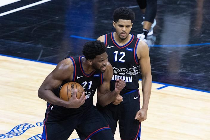 Joel Embiid (21) and Tobias Harris have led the 76ers to the No. 1 seed in the Eastern Conference.