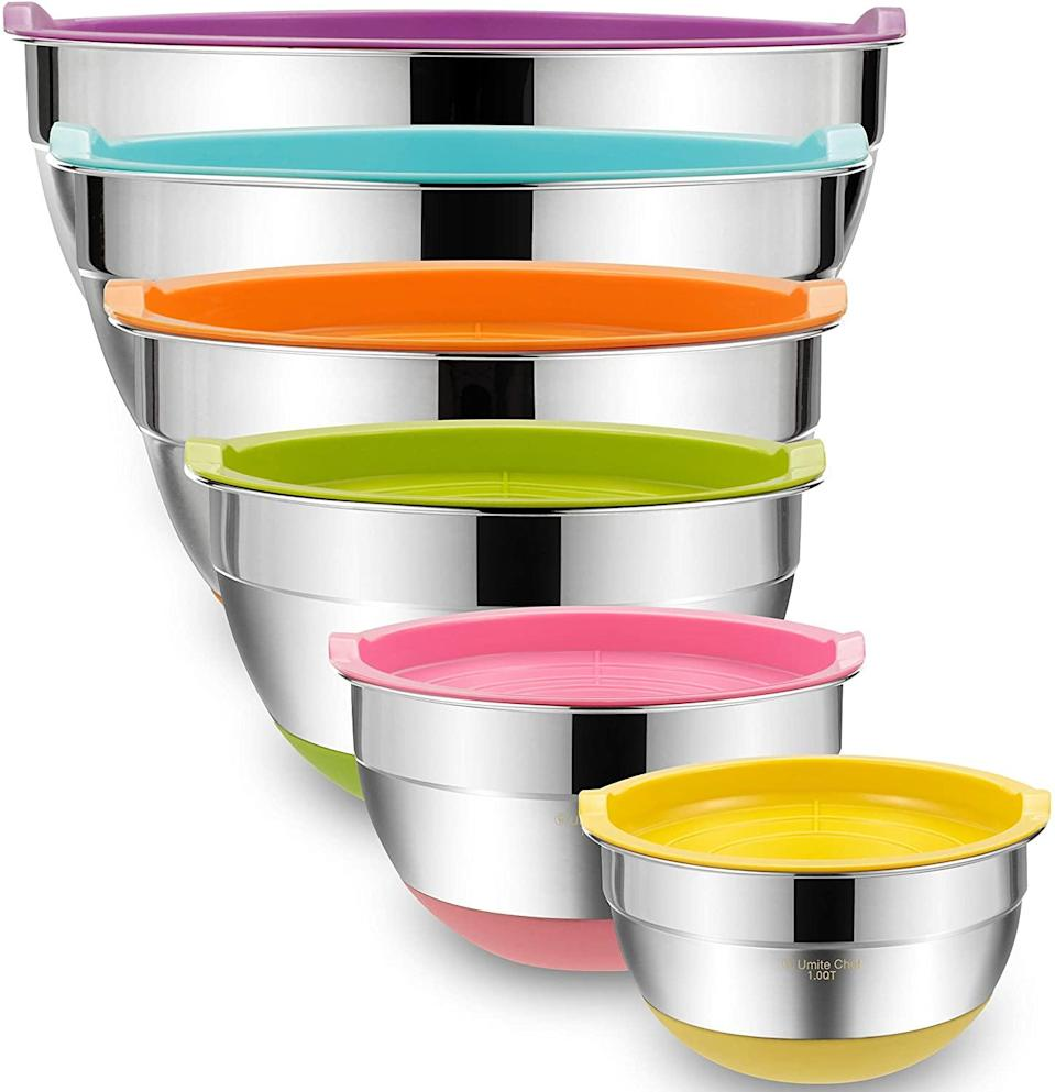 """If you know you'll need a bunch of mixing bowls of various sizes, this set of six nesting bowls is ideal. At less than $30, it offers both quantity <em>and</em> quality. The bowls are made of premium stainless steel that's rustproof and dishwasher-safe—and they feature non-slip silicone bases. They also come with lids that are super handy if you need to store leftovers or chill dough. Plus, these bowls are a bit deeper than most, making them ideal for holding batters, sauces, and doughs with minimum spraying and splashing. $29, Amazon. <a href=""""https://www.amazon.com/Airtight-Stainless-Umite-Chef-Measurement/dp/B07Q2BJBJ6/"""" rel=""""nofollow noopener"""" target=""""_blank"""" data-ylk=""""slk:Get it now!"""" class=""""link rapid-noclick-resp"""">Get it now!</a>"""