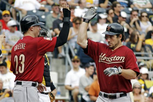 Houston Astros' Brett Wallace (29) is greeted by Tyler Greene (23) as he crosses home plate after hitting a three-run home run off Pittsburgh Pirates pitcher Jeff Locke in the fifth inning of a baseball game in Pittsburgh, Monday, Sept. 3, 2012. (AP Photo/Gene J. Puskar)