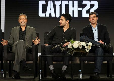"Actor, executive producer, and director George Clooney (L-R), actor Christopher Abbott, and actor Kyle Chandler speak on a panel for the Hulu series ""Catch-22"", during the Television Critics Association (TCA) Winter Press Tour in Pasadena, California, U.S., February 11, 2019.  REUTERS/Lucy Nicholson"