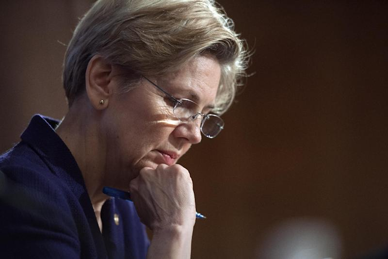 """FILE - In this March 7, 2013 file photo, Sen. Elizabeth Warren, D-Mass., pauses while questioning a witness at Senate Banking Committee hearing on anti-money laundering on Capitol Hill in Washington.  The Massachusetts Democrat is working on a book she plans to call """"Rigged."""" During a brief telephone interview Tuesday, March 19, 2013,  with The Associated Press, she said """"Rigged"""" will be a """"first-hand"""" account of her battles for the middle class. She will write about helping to set up the Consumer Financial Protection Bureau and her senate campaign in 2012.  (AP Photo/Cliff Owen)"""