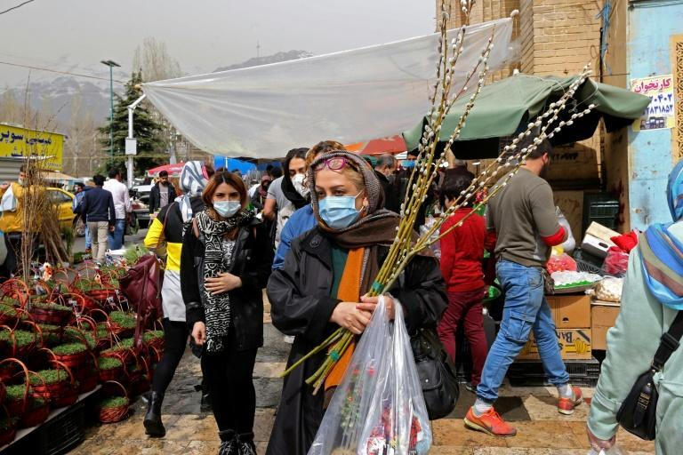 Mask-clad Iranians shop amid the Covid-19 pandemic at the Tajrish Bazaar in Tehran as Iran prepares to celebrate Nowruz, the Iranian New Year