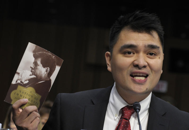 Pulitzer Prize-winning journalist, immigration rights activist and self-declared undocumented immigrant Jose Antonio Vargas testifies on Capitol Hill in Washington, Wednesday, Feb. 13, 2013, before the Senate Judiciary Committee hearing on comprehensive immigration reform.  (AP Photo/Susan Walsh)