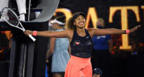 Japan's Naomi Osaka celebrates after defeating United States' Jennifer Brady in the women's singles final at the Australian Open tennis championship in Melbourne, Australia, Saturday, Feb. 20, 2021(AP Photo/Andy Brownbill)