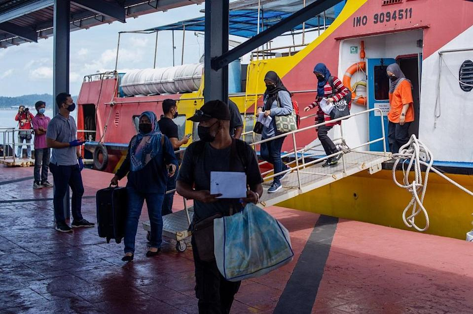 Passengers arrive at Kuah Ferry Terminal in Langkawi September 16, 2021. ― Pictures by Shafwan Zaidon