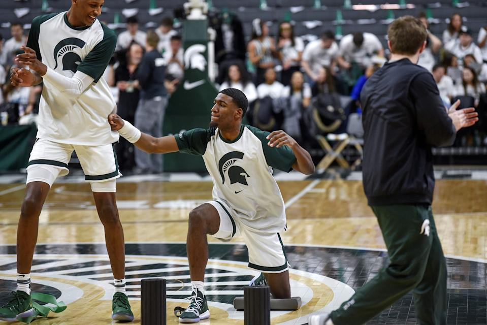 Michigan State's Aaron Henry, right, jokes around with Marcus Bingham Jr. before the game against Michigan on Saturday, March 9, 2019, at the Breslin Center in East Lansing.
