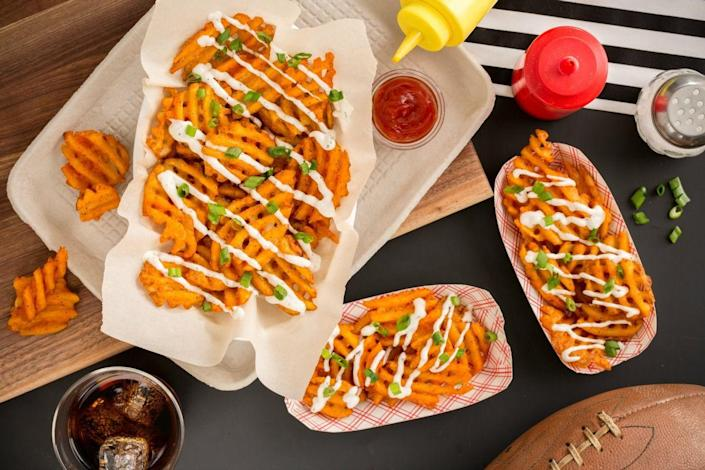 """<p>Chick-fil-A waffle fries got nothing on these.</p><p>Get the recipe from <a href=""""https://www.delish.com/entertaining/videos/a45679/delish-snack-stadium/"""" rel=""""nofollow noopener"""" target=""""_blank"""" data-ylk=""""slk:Delish"""" class=""""link rapid-noclick-resp"""">Delish</a>.</p>"""