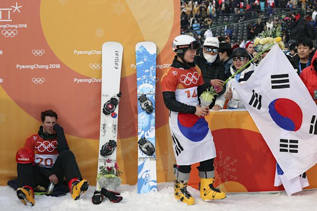 <p>Third placed Zan Kosir of Slovenia sits while second placed Lee Sang-ho of South Korea is congratulated by supporters. REUTERS/Mike Blake </p>