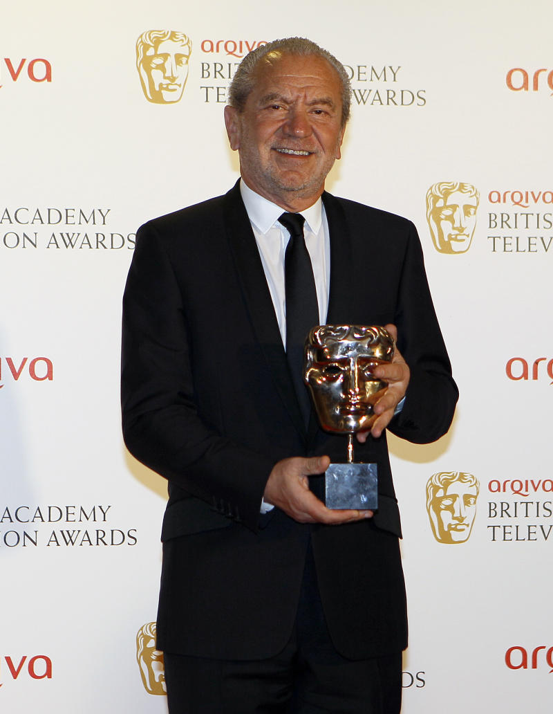 British businessman Alan Sugar holds the Reality and Factual Award for Young Apprentice at the British Academy Television Awards in London, Sunday, May 27, 2012. (AP Photo/Kirsty Wigglesworth)