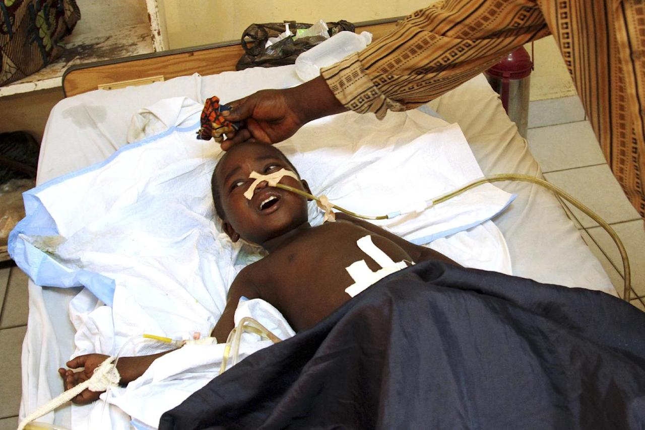 An 11-year-old boy, accompanied by his father, receives treatment at the HEAL Africa hospital after being shot in the abdomen during a firefight between Congolese police and attacking M23 rebels, in Goma, eastern Congo, Wednesday, Nov. 21, 2012. Thousands of Congolese soldiers and policemen defected to the M23 rebels Wednesday, as rebel leaders vowed to take control of all Congo, including the capital Kinshasa. (AP Photo/Marc Hofer)