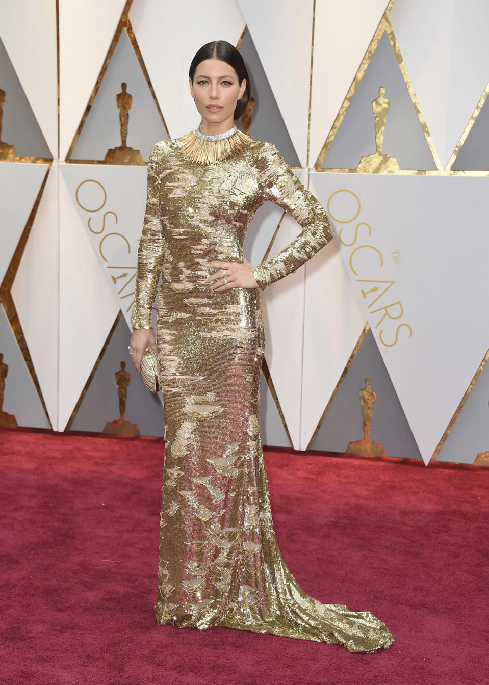 <p>Jessica Biel's form-fitting Kaufman Franco gold gown was already stunning. Then, she basically assured herself a spot on the best dressed list by adding lots of Tiffany & Co. bling, most notably a necklace with more than<span> 350 uniquely shaped 18 karat gold fronds and m</span><span>ore than 200 baguette diamonds. She also wore a $21,500 ring. </span><em>(Photo: Getty Images)</em> </p>
