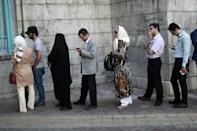 Huge turnout as Iranians deliver verdict on Rouhani