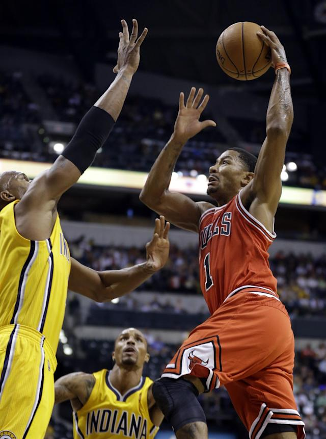 Chicago Bulls guard Derrick Rose, right, goes up for a shot over Indiana Pacers forward David West, left, in the first half of an NBA preseason basketball game in Indianapolis, Saturday, Oct. 5, 2013. (AP Photo/Michael Conroy)