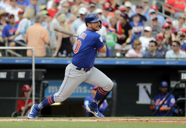 FILE - In this Feb. 28, 2019, file photo, New York Mets' Pete Alonso hits a single during the first inning of an exhibition spring training baseball game against the St. Louis Cardinals in Jupiter, Fla. Alonso is hitting .406 at spring training and leads the Mets with three home runs, yet he may start the season in the minor leagues. (AP Photo/Jeff Roberson, File)