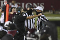 Mississippi State coach Mike Leach talks to an official during the first half of the team's NCAA college football game against Arkansas in Starkville, Miss., Saturday, Oct. 3, 2020. (AP Photo/Thomas Graning)