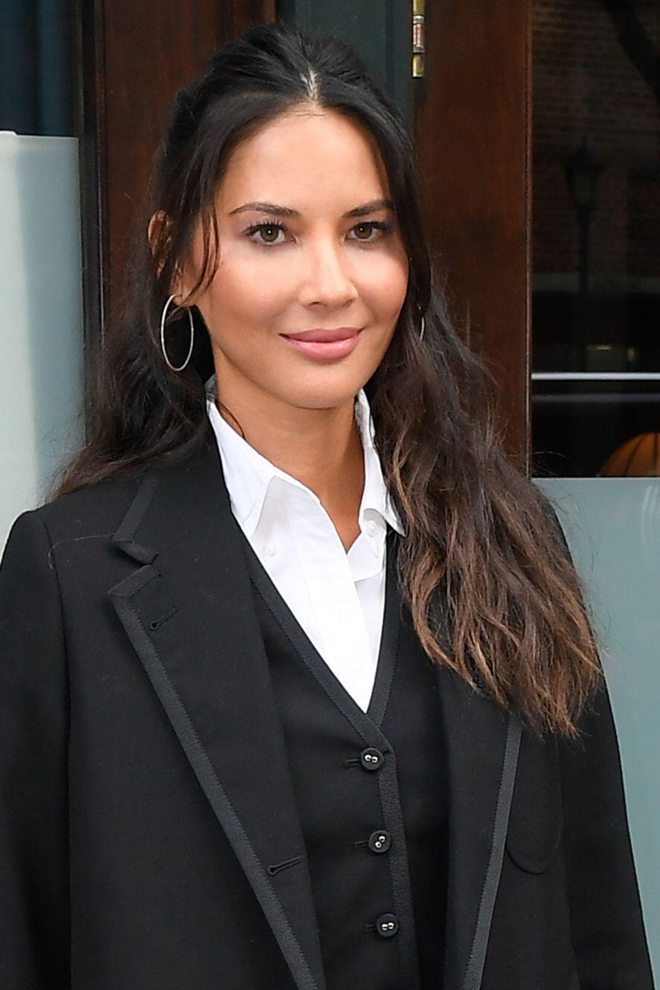 <p>Elevate loose waves in a half-up, half-down style like Olivia Munn. It's even easier to do on unwashed hair. If you have layers, leave the shortest strands out to fall gently in front. </p>
