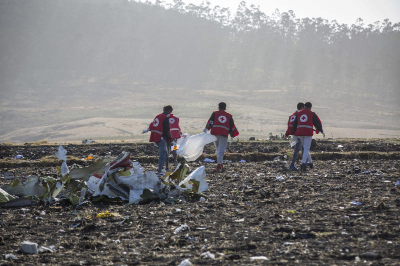 FILE - In this March 11, 2019, file photo, rescuers work at the scene of an Ethiopian Airlines flight crash near Bishoftu, or Debre Zeit, south of Addis Ababa, Ethiopia. Paul Njoroge, who lost his wife and three young children in the March 10 crash of an Ethiopian Airlines' Boeing 737 Max 8 aircraft, believes Boeing should scrap the 737 Max, and he wants the company's top executives to resign and face criminal charges for not grounding the plane after a deadly accident last October. On Wednesday, July 17, Njoroge will be the first relative of any of the 346 passengers who died in those crashes to testify before Congress. (AP Photo/Mulugeta Ayene)