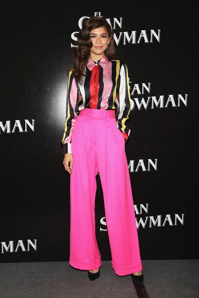 <p>The young actress was a standout in a brightly colored Maria Escote shirt and hot pink Styland pants at an earlier press conference in Mexico City. (Photo: Getty Images) </p>