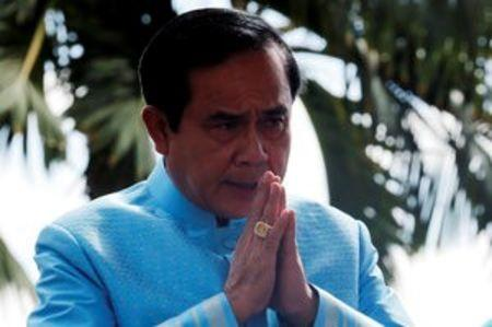 Thailand's Prime Minister Prayuth Chan-ocha gestures as he arrives at a weekly cabinet meeting at Government House in Bangkok