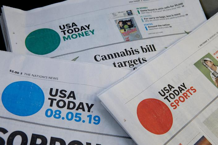 Sections of a USA TODAY newspapers.