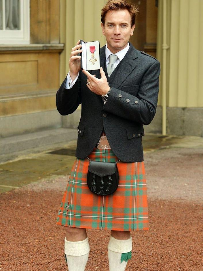 <p>Ewan McGregor received an OBE from the Queen in 2013 and the Scottish actor sported the traditional kilt for the honor—high knee socks and all. </p>