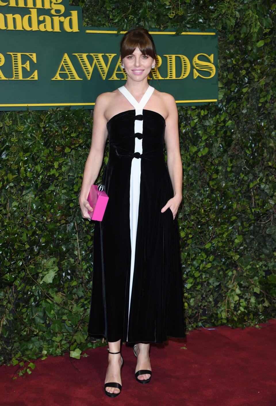 <p>The stage star wore a black-and-white Emporio Armani dress that riffed on a suit. <i>[Photo: Getty]</i> </p>