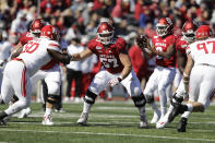 In this photo taken on Saturday, Oct. 12, 2019, Indiana offensive lineman Harry Crider (57) blocks during the second half of an NCAA college football game against Rutgers, in Bloomington, Ind. The Hoosiers could be headed to a second straight bowl game despite a brutal schedule that begins with Penn State visiting Bloomington, Indiana, on Oct. 24.(AP Photo/Darron Cummings)