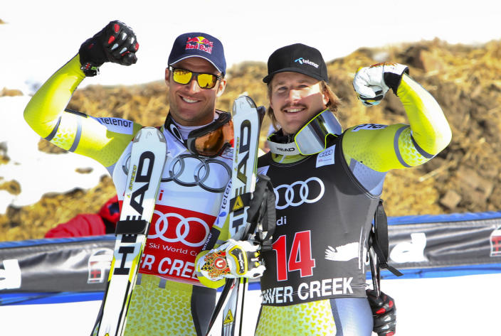 Norway's Aksel Lund Svindal, left, who finished second, along withth his teammate Kjetil Jansrud, who finished third, pose for photographers after the men's World Cup downhill ski race in Beaver Creek, Colo., on Friday, Nov. 30, 2012. (AP Photo/Alessandro Trovati)