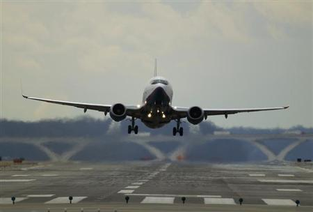 A passenger jet lifts off at Reagan National Airport in Washington
