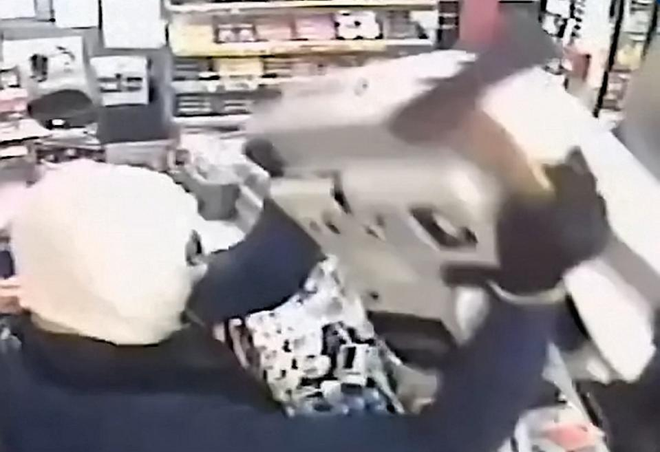 The men smashed up the till with an axe (Picture: SWNS)
