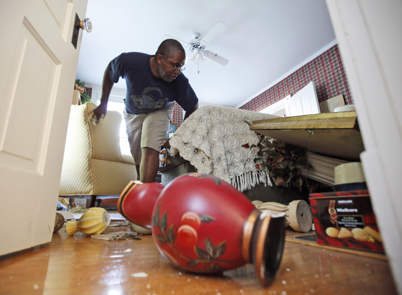 Tony Williams surveys damage at his Mineral, Va. home after an earthquake struck Tuesday, Aug. 23, 2011. Items in his home were knocked over and displaced, and the home suffered some structural damage after the most powerful earthquake to strike the East Coast in 67 years shook buildings and rattled nerves from South Carolina to New England. The quake was centered near Mineral, a small town northwest of Richmond. (AP Photo/Steve Helber)