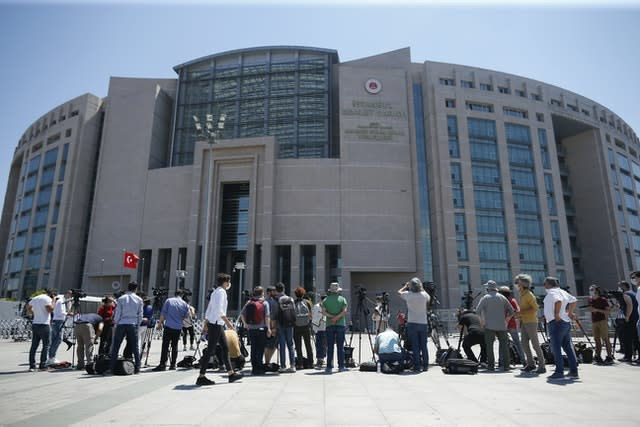 Members of the media work outside the court in Istanbul (Emrah Gurel/AP)
