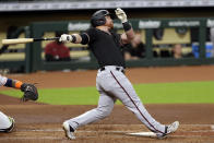 Arizona Diamondbacks' Kole Calhoun watches his home run during the second inning of a baseball game against the Houston Astros Saturday, Sept. 19, 2020, in Houston. (AP Photo/Michael Wyke)
