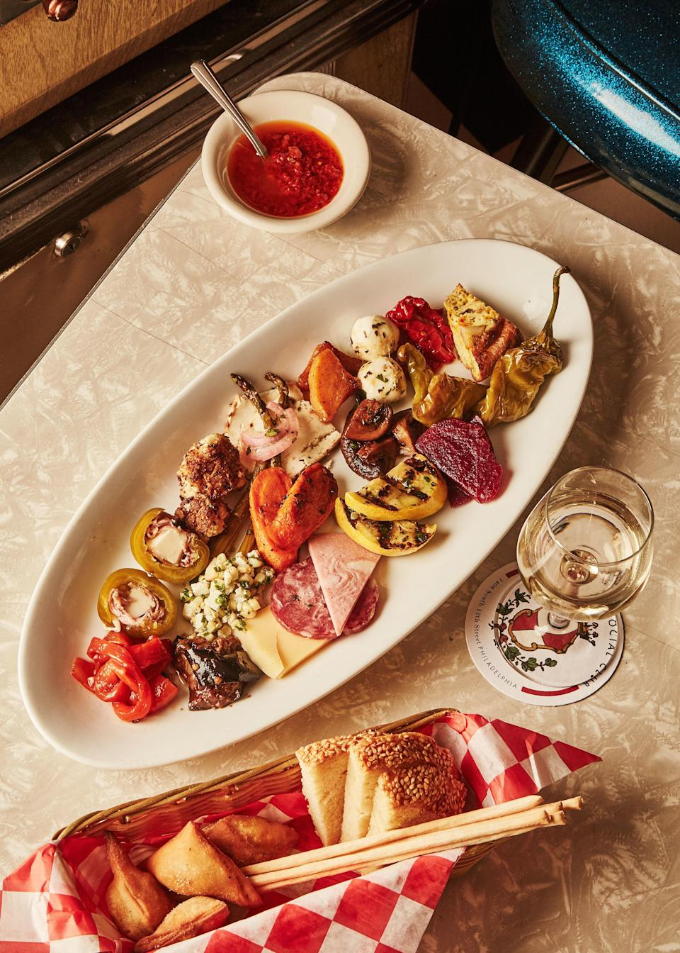 "An antipasto platter doesn't have to be a boring collection of cold cuts. Well-seasoned roasted seasonal vegetables add a ton of character and flavor to the mix. <a href=""https://www.epicurious.com/recipes/food/views/roasted-vegetables-antipasto-plate?mbid=synd_yahoo_rss"" rel=""nofollow noopener"" target=""_blank"" data-ylk=""slk:See recipe."" class=""link rapid-noclick-resp"">See recipe.</a>"