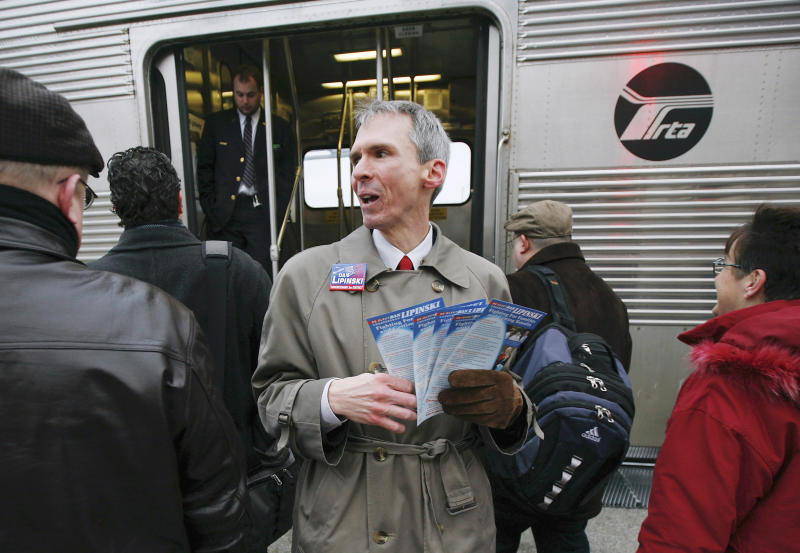 """FILE - In this Jan. 14, 2008 file photo, U.S. Rep. Dan Lipinski, D-Ill., campaigns for re-election at a Metra commuter train station in Berwyn, Ill. Lipinski says public transit agencies nationwide are being targeted with questionable lawsuits by """"patent trolls"""" that are squeezing settlements out of financially strapped public entities unable to mount legal defenses. Lipinski says at least 20 public transit agencies, including the Chicago area's Metra, have been targeted. (AP Photo/Brian Kersey, File)"""