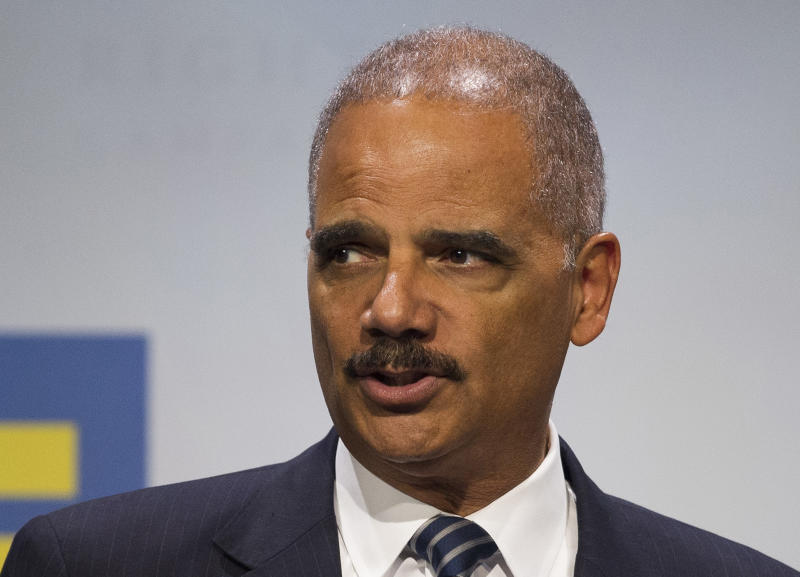 FILE - In this Sept. 15, 2018 file photo, former Attorney General Eric Holder addresses the Human Rights Campaign National Dinner in Washington, D.C. Virginians will elect members of the House of Delegates this year using a map seen as favorable to Democrats, according to a ruling Monday, June 17, 2019 by the U.S. Supreme Court.  The lawsuit challenging the original House lines was backed by the National Democratic Redistricting Committee, led by former U.S. Attorney General Eric Holder. (AP Photo/Cliff Owen, File)