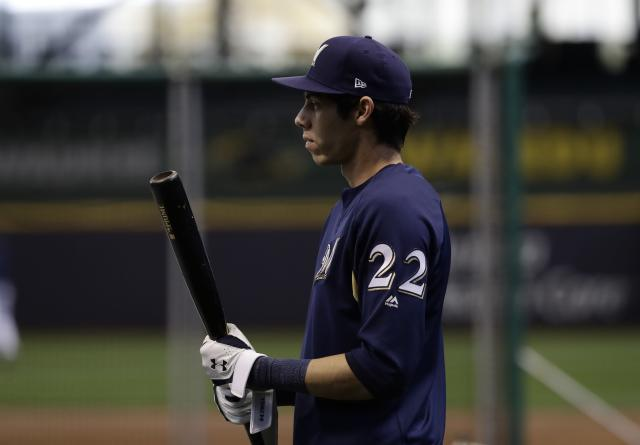 Milwaukee Brewers' Christian Yelich warms up for practice for Game 1 of the National League Championship Series baseball game Los Angeles Dodgers Thursday, Oct. 11, 2018, in Milwaukee. (AP Photo/Matt Slocum)
