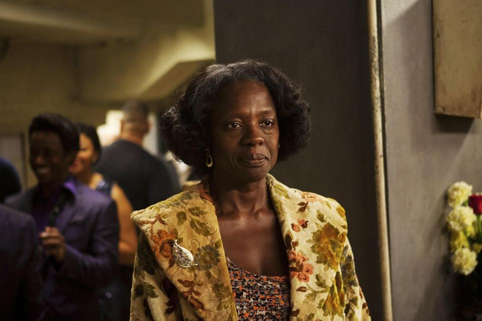 """Davis comes in and out of 2014's <em>Get on Up</em>, the harrowing biopic charting the highs and lows in the life of musical genius and dazzling showman James Brown. Reuniting with <em>The Help</em> director <strong>Tate Taylor,</strong> Davis brings humanity and empathy to the often-absent mother of the Godfather of Soul, deftly portrayed by a then up-and-coming Chadwick Boseman. The <a href=""""https://www.youtube.com/watch?v=6lQepH1Cn9M&t=224s"""" rel=""""nofollow noopener"""" target=""""_blank"""" data-ylk=""""slk:chemistry between Davis and Boseman"""" class=""""link rapid-noclick-resp"""">chemistry between Davis and Boseman</a> that would eventually light up the screen in <em>Ma Rainey's Black Bottom</em> was evident in <em>Get on Up</em> as well, as the two explored the damaged relationship between a mother and son."""