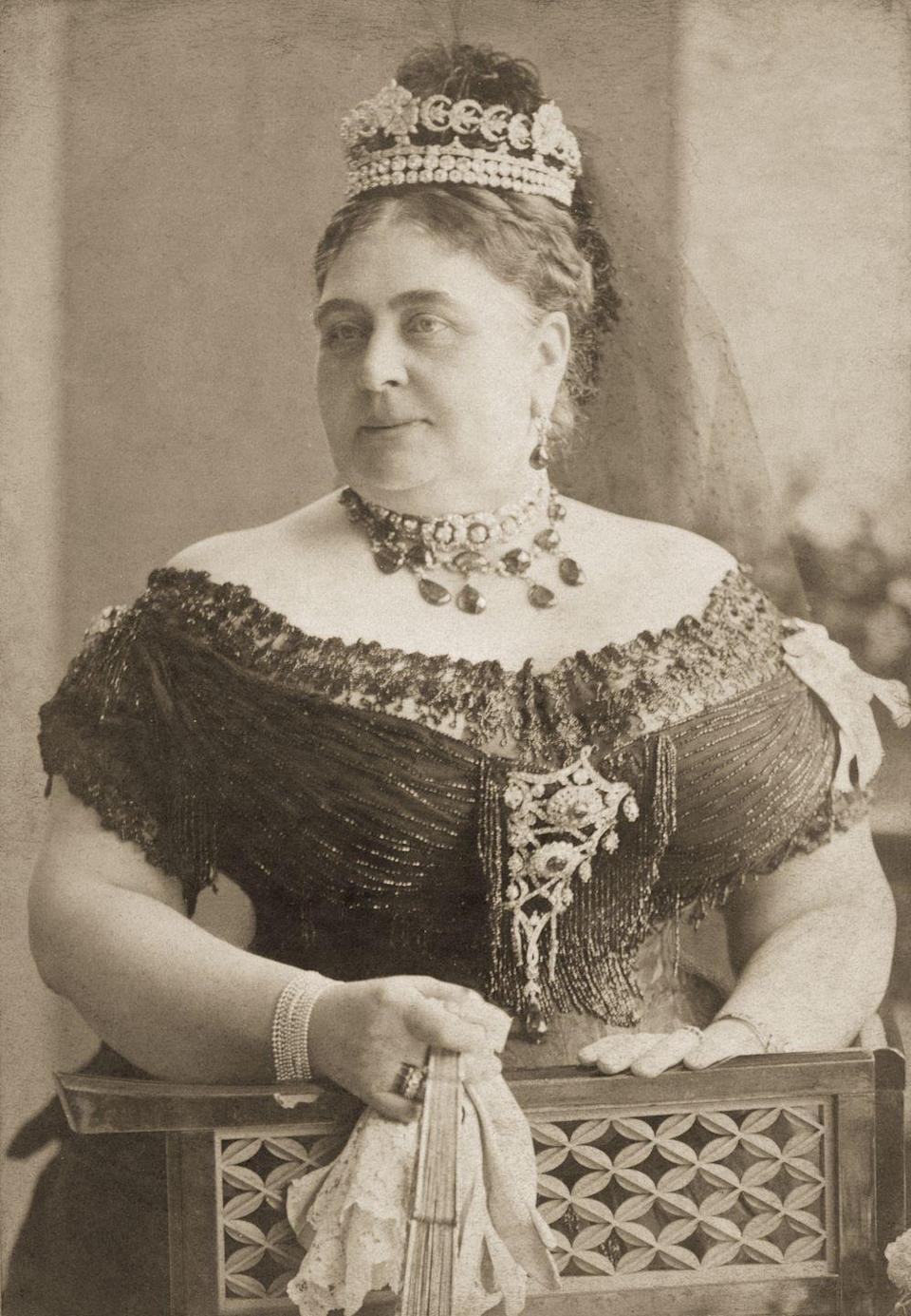 "<p>The Teck Crescent Tiara, characterized by its three diamond roses and 20 diamond crescents, was created from pieces of jewels inherited by Queen Mary's mother, the Duchess of Teck, from her aunt, the Duchess of Gloucester. It eventually found its way into the Queen Mother's possession, and was later inherited by Queen Elizabeth, but hasn't been seen in public since 1939, per the <a href=""http://www.thecourtjeweller.com/2017/01/the-teck-crescent-tiara.html"" rel=""nofollow noopener"" target=""_blank"" data-ylk=""slk:Court Jeweller"" class=""link rapid-noclick-resp"">Court Jeweller</a>.<br></p>"