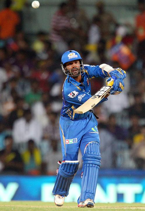 Dinesh Karthik during match 5 of of the Pepsi Indian Premier League between The Chennai Superkings and the Mumbai Indians held at the MA Chidambaram Stadiumin Chennai on the 6th April 2013..Photo by Ron Gaunt-IPL-SPORTZPICS ..Use of this image is subject to the terms and conditions as outlined by the BCCI. These terms can be found by following this link:..https://ec.yimg.com/ec?url=http%3a%2f%2fwww.sportzpics.co.za%2fimage%2fI0000SoRagM2cIEc&t=1490675168&sig=F78vXvBqX.1vngGTydSY1Q--~C