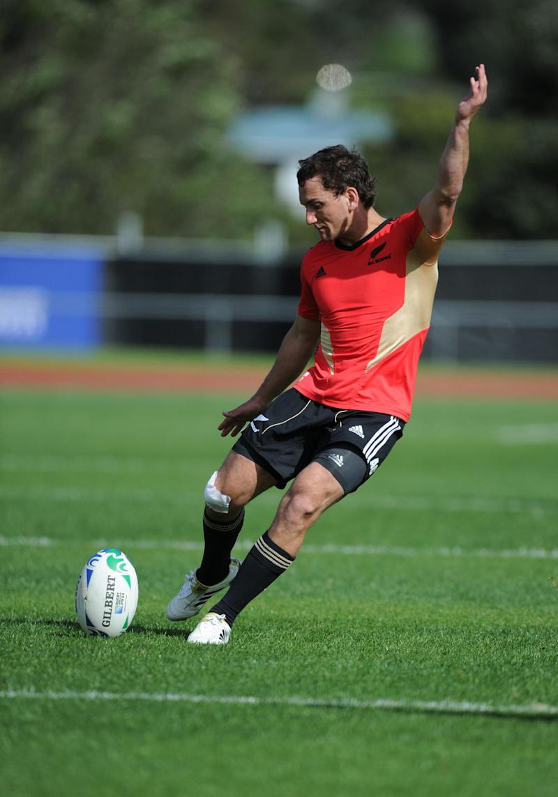 New Zealand rugby player Aaron Cruden kicks a drop goal during training in Auckland, New Zealand, Friday, Oct 14, 2011. New Zealand will play Australia in their Rugby World Cup semifinal on Sunday, Oct 16.  (AP Photo/Ross Land)
