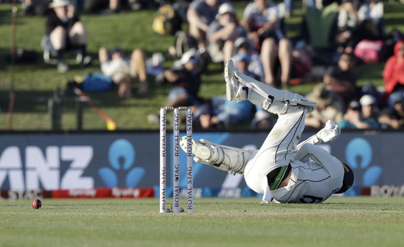 New Zealand's Tom Blundell falls after he was hit by the ball during play on day one of the second cricket test between New Zealand and India at Hagley Oval in Christchurch, New Zealand, Saturday, Feb. 29, 2020. (AP Photo/Mark Baker)