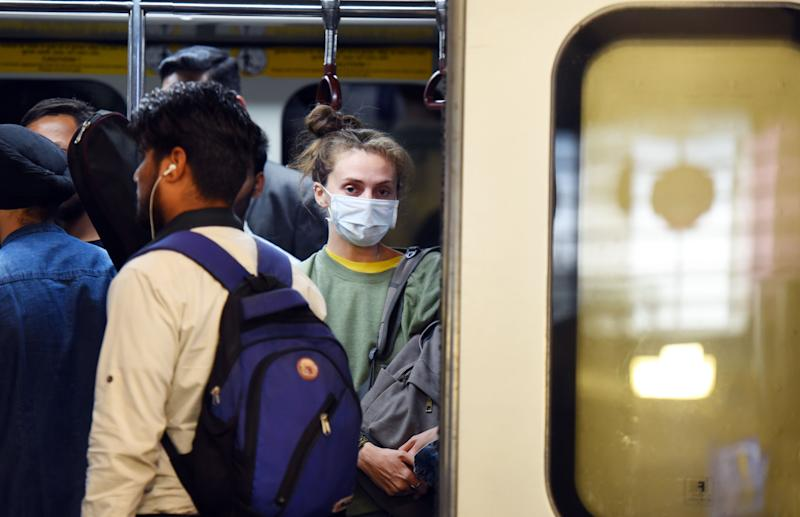 NEW DELHI, INDIA - MARCH 13: Commuters are seen at Rajiv Chowk Metro Station, some wearing protective masks as a precautionary measure amid rising coronavirus scare, on March 13, 2020 in New Delhi, India. The Delhi government on Thursday declared coronavirus an epidemic and shut all cinema halls, schools and colleges, except those where exams are on, till March 31. (Photo by Raj K Raj/Hindustan Times via Getty Images)